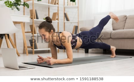 woman doing yoga indoors stock photo © hasloo