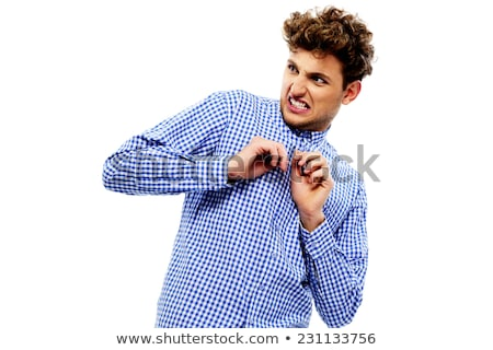 Portrait of a young disgusted man over white background Stock photo © deandrobot