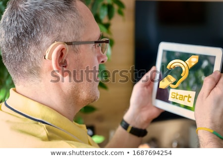 deafness on the display of medical tablet stock photo © tashatuvango