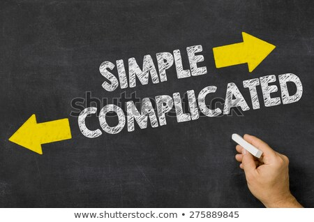 Simple or Complicated written on a blackboard Stock photo © Zerbor