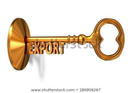 Export - Golden Key is Inserted into the Keyhole. Stock photo © tashatuvango