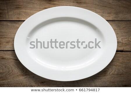 Empty oval plate on vintage wooden table Stock photo © vinnstock