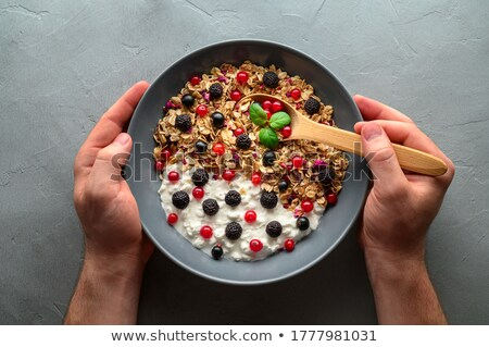 Holding raspberries and black currants in the hand Stock photo © simply