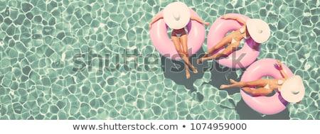 Three relaxed women in the swimming pool Stock photo © dashapetrenko