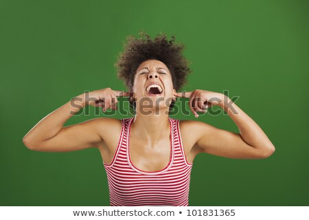 African woman covering her ears with finger and screaming Stock photo © deandrobot