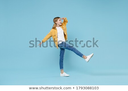 Teljes alakos portré kicsi iskolás lány áll karok Stock fotó © deandrobot