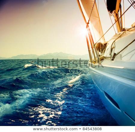 Sail boat against sunset Stock photo © vapi