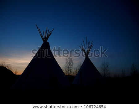 Native American Indian in the tent at sunset Stock photo © adrenalina
