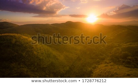 sunrise over mountains silhouettes stock photo © byrdyak