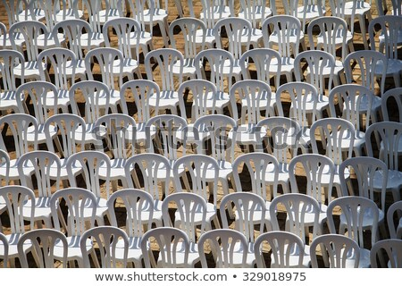 Patter composed by chairs of white plastic  Stock photo © CaptureLight