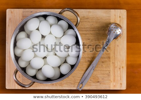 Boiled white hens eggs cooling for decorating Stock photo © ozgur