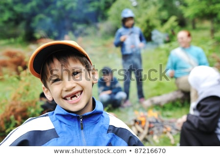 barbecue in nature group of children preparing sausages on fire stock photo © zurijeta