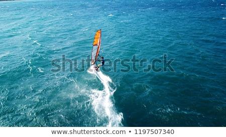 Lány szörfös szörfdeszka nyitva tenger nő Stock fotó © Kzenon
