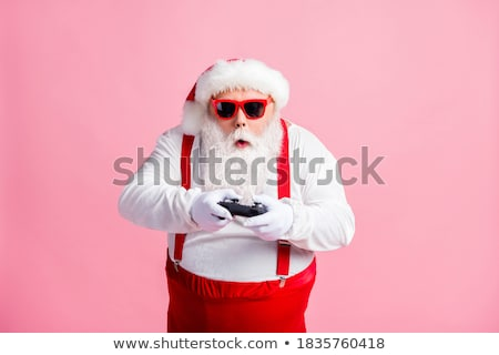Man using game pad controller to play video games Stock photo © stevanovicigor