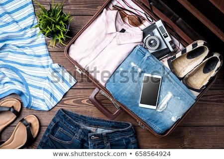 közelkép · nő · bőrönd · zárt · túlzás · ruházat - stock fotó © dolgachov