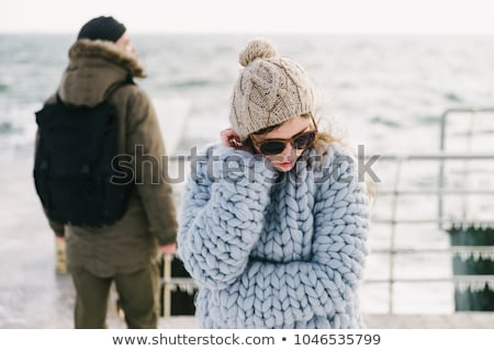 Young beautiful girl in suglasses standing at the sea pier Stock photo © deandrobot