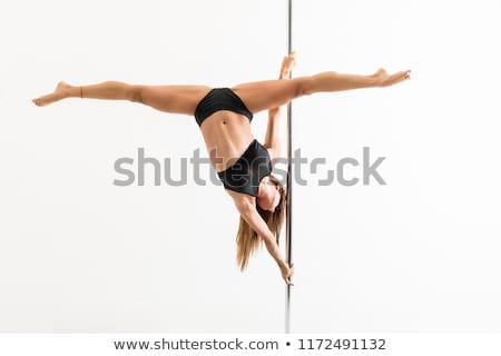női · pólus · táncos · nyújtott · lábak · stúdió - stock fotó © bezikus
