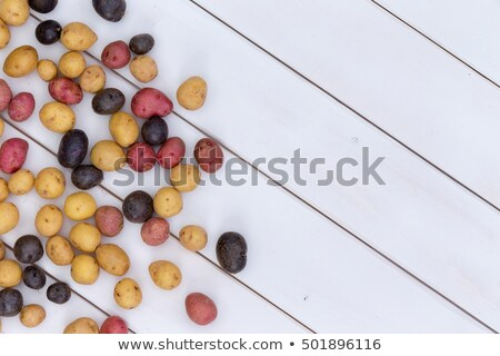 scattered fresh multicolored baby potatoes stock photo © ozgur