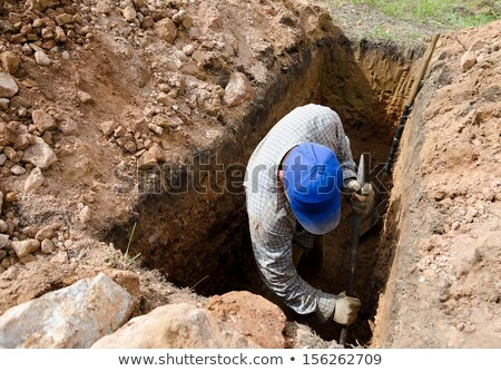 A man digging a grave Stock photo © bluering