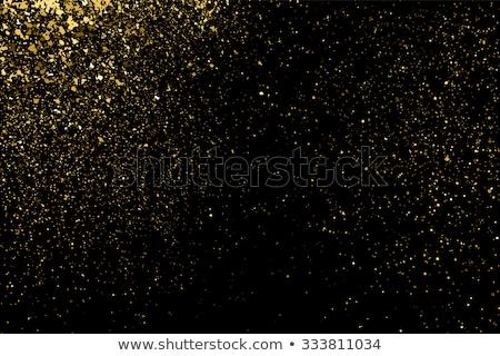 Gold sparkles on white. EPS 10 Stock photo © beholdereye
