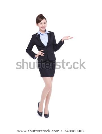 Asian businesswoman displaying something Stock photo © szefei
