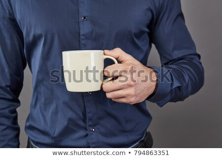Bearded businessman holding coffee and yawning Stock photo © deandrobot