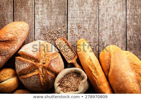 assortment of fresh baked bread on wooden table background stock photo © yatsenko
