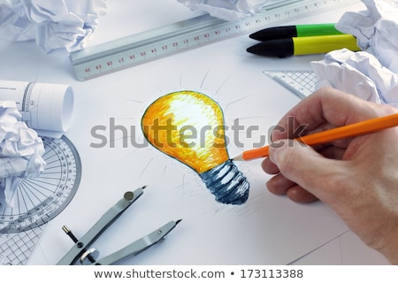 Colourful lightbulb with drawings graphics stock photo © wavebreak_media