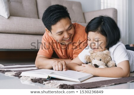 Cute woman as a doll in her living room Stock photo © konradbak