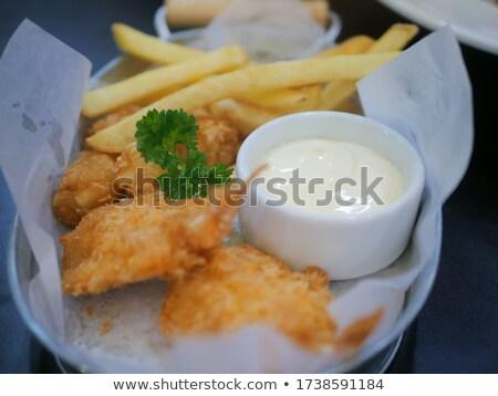 Frit poissons frites françaises servi mixte légumes Photo stock © Digifoodstock