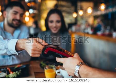 pagamento · café · vista · lateral · mãos · garçonete · eletrônico - foto stock © lightfieldstudios