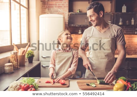 Cropped image of smiling woman in apron cooking Stock photo © deandrobot