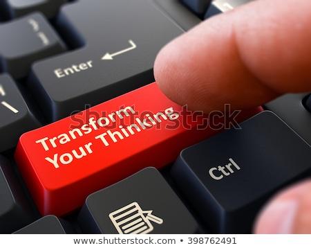 Hand Finger Press Transform Your Thinking Button. 3D. Stock photo © tashatuvango