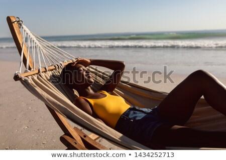 女性 リラックス ハンモック 笑顔の女性 笑みを浮かべて 図書 ストックフォト © IS2