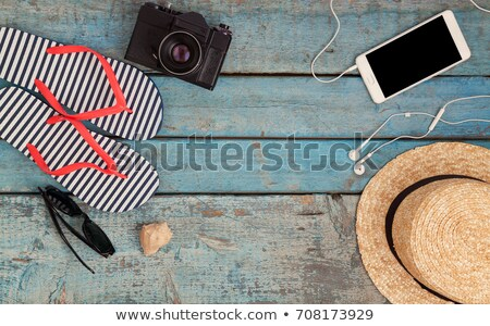 still life of different items for relaxing on the beach rubber stock photo © tanach