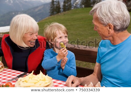 couple and grandson eating in mountains Stock photo © IS2