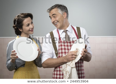 husband and wife cleaning dishes stock photo © monkey_business