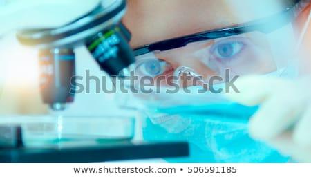 Medical science researcher performing test in laboratory Stock photo © stevanovicigor