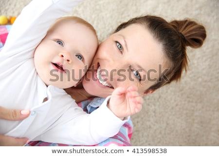 Szczęśliwy kobieta opieki baby niebieski Zdjęcia stock © Imaagio