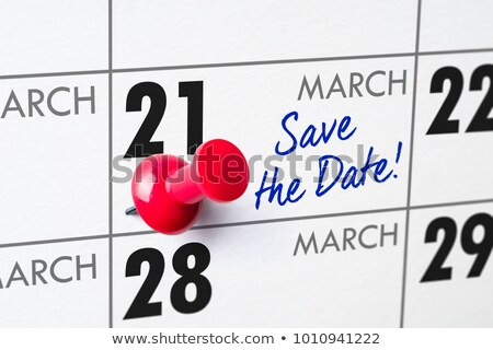 wall calendar with a red pin   march 21 stock photo © zerbor