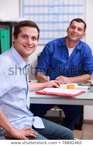 Two men in a garage discussing a sale. Stock photo © IS2