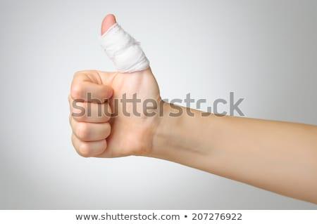 herido · pulgar · vendaje · doloroso · blanco · jóvenes - foto stock © CsDeli