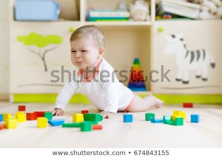 caucasian boy crying and holding toy stock photo © rastudio
