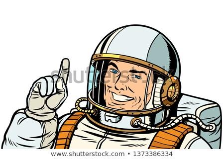 male astronaut pointing up, isolate on white background Stock photo © studiostoks