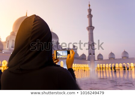 woman taking picture of sheikh zayed grand mosque stock photo © dashapetrenko