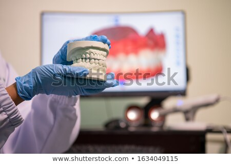 Dental technician work on denture prothesis in dental laboratory Stock photo © adamr