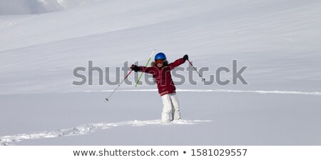 Happy girl on off-piste slope with new fallen snow at nice winte Stock photo © BSANI