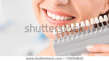 Woman Matching Shade Of The Implant Teeth Stock photo © AndreyPopov