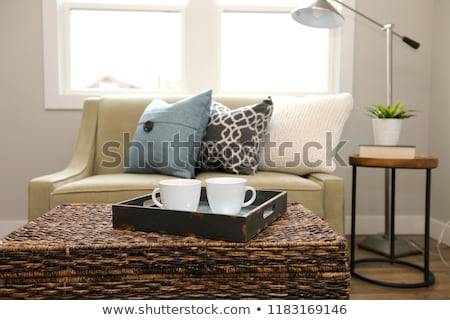 Rattan trunk coffee table with a wood tray and white cups  Stock photo © iriana88w