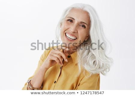 A nice elderly woman on studio white background Stock photo © Lopolo